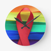 AIDS awareness red ribbon on gay flag Round Clock