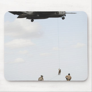 Air Force pararescuemen conduct a combat insert Mouse Pad