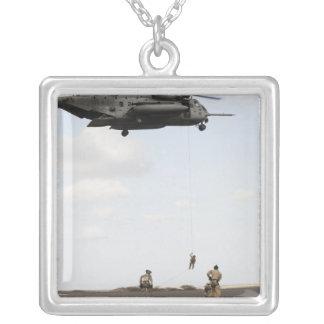 Air Force pararescuemen conduct a combat insert Square Pendant Necklace