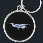 "Aircraft Classic Cessna Silhouette Flying on Black Keychain<br><div class=""desc"">Aircraft Classic Cessna Silhouette Flying on black for any aviation enthusiast, customize this with text if you wish. The Cessna airplane is designed to make it look like a silver chrome applique. Easily add text to this design in one step. Just click on the &quot;Customize It!&quot; button to reveal the...</div>"