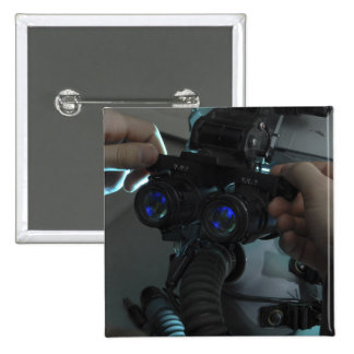 Airman adjusts the eyespan button