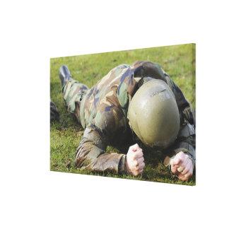 Airman crawls through a wet field canvas print
