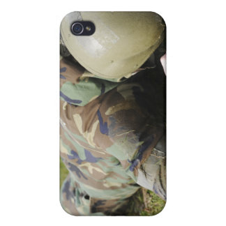 Airman crawls through a wet field cover for iPhone 4