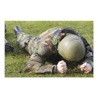 Airman crawls through a wet field photo print