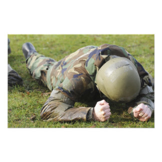 Airman crawls through a wet field photographic print