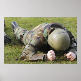 Airman crawls through a wet field poster