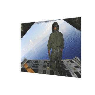 Airman observes the waters of the Gulf of Mexic Canvas Print