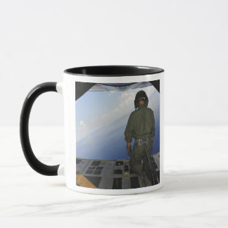 Airman observes the waters of the Gulf of Mexic Mug