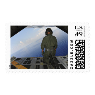 Airman observes the waters of the Gulf of Mexic Stamp