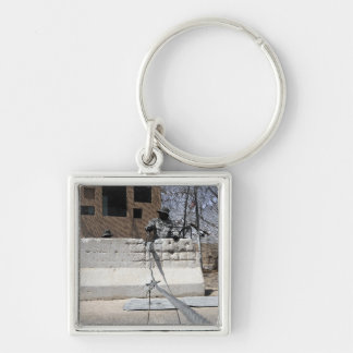 Airman stands post to the entry control point keychain