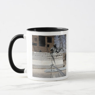 Airman stands post to the entry control point mug