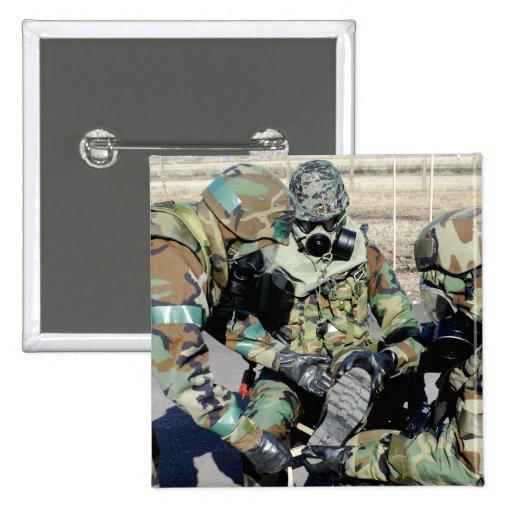 Airmen assist a Republic of Korea Army soldier 2 Inch Square Button