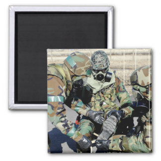Airmen assist a Republic of Korea Army soldier 2 Inch Square Magnet