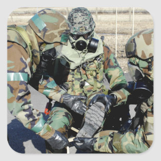 Airmen assist a Republic of Korea Army soldier Square Sticker