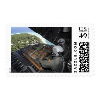 Airmen push out a pallet of donated goods 2 stamp