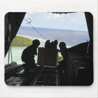 Airmen push out a pallet of donated goods mouse pad