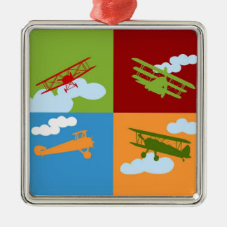 Airplane collage on blue, redm green and orange. metal ornament