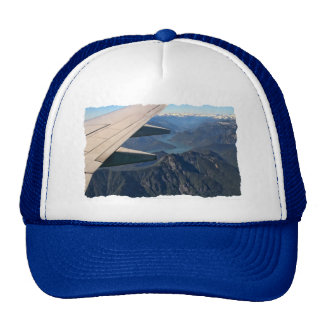 Airplane Flying Over the Rocky Mountains Trucker Hat