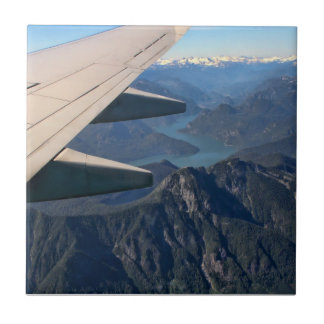 Airplane Flying Over the Rocky Mountains Tiles