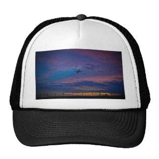 Airplane on multicoloured sky mesh hats