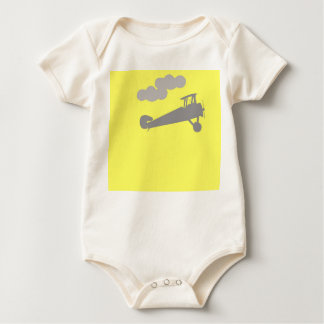 Airplane on plain blue background. baby bodysuit