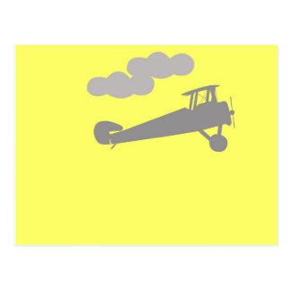 Airplane on plain blue background. postcard