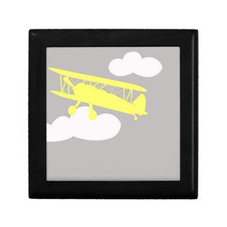 Airplane on plain grey background. jewelry box
