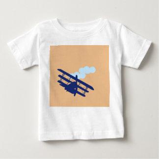 Airplane on plain orange background. baby T-Shirt