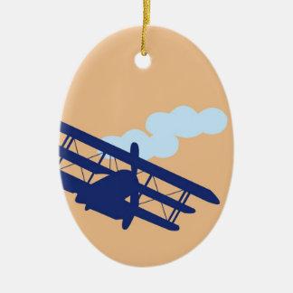 Airplane on plain orange background. ceramic ornament