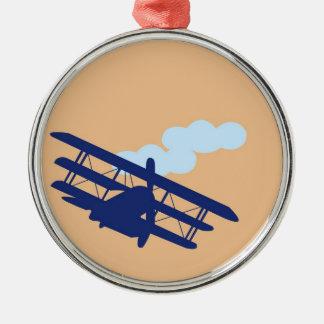Airplane on plain orange background. metal ornament