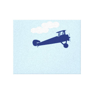 Airplane on plain pastel blue background. canvas print