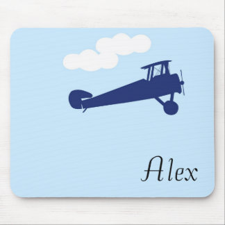 Airplane on plain pastel blue background. mouse pad
