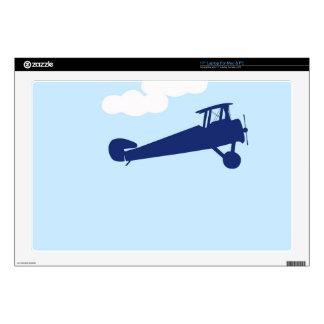 "Airplane on plain pastel blue background. 17"" laptop skins"