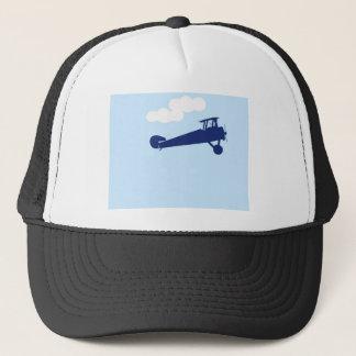 Airplane on plain pastel blue background. trucker hat