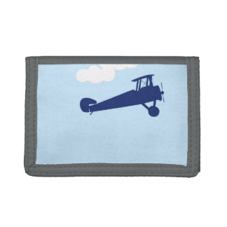 Airplane on plain pastel blue background. wallets