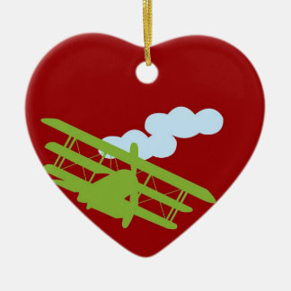 Airplane on plain red background. ceramic ornament