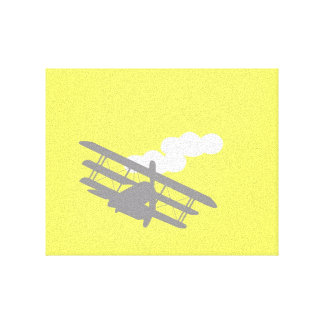 Airplane on plain yellow background. canvas print