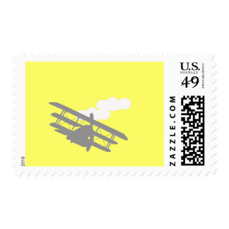 Airplane on plain yellow background. postage stamps