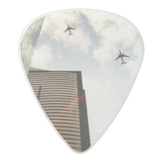 Airplanes flying over buildings acetal guitar pick