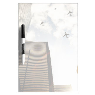 Airplanes flying over buildings Dry-Erase board