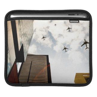 Airplanes flying over buildings iPad sleeves