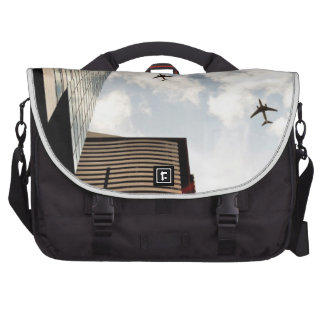 Airplanes flying over buildings laptop messenger bag