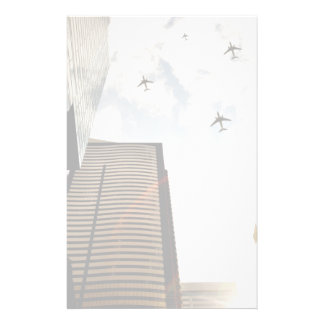 Airplanes flying over buildings stationery