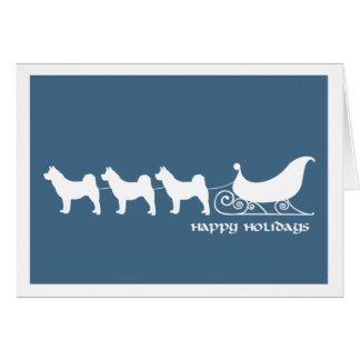 Akitas que tira del trineo de Santas Felicitacion