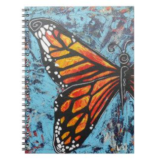 Ala de la mariposa de monarca de las creaciones de libreta