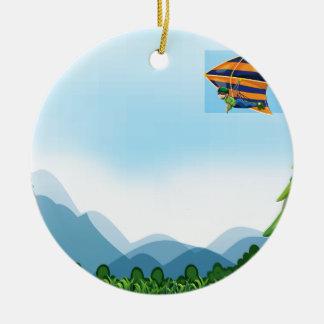 Ala delta adorno navideño redondo de cerámica