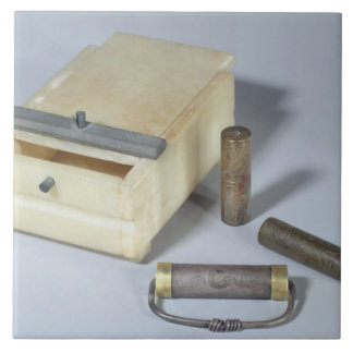 Alabaster box and bronze and silver seal cylinders ceramic tile