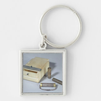 Alabaster box and bronze and silver seal cylinders Silver-Colored square keychain