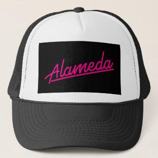 Alameda in magenta trucker hat