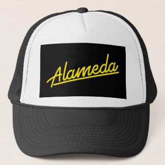 Alameda in yellow trucker hat
